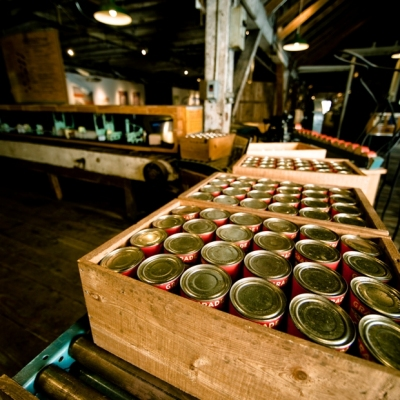 Display of boxes full of cans inside the Gulf of Georgia Cannery National Historic Site in Steveston